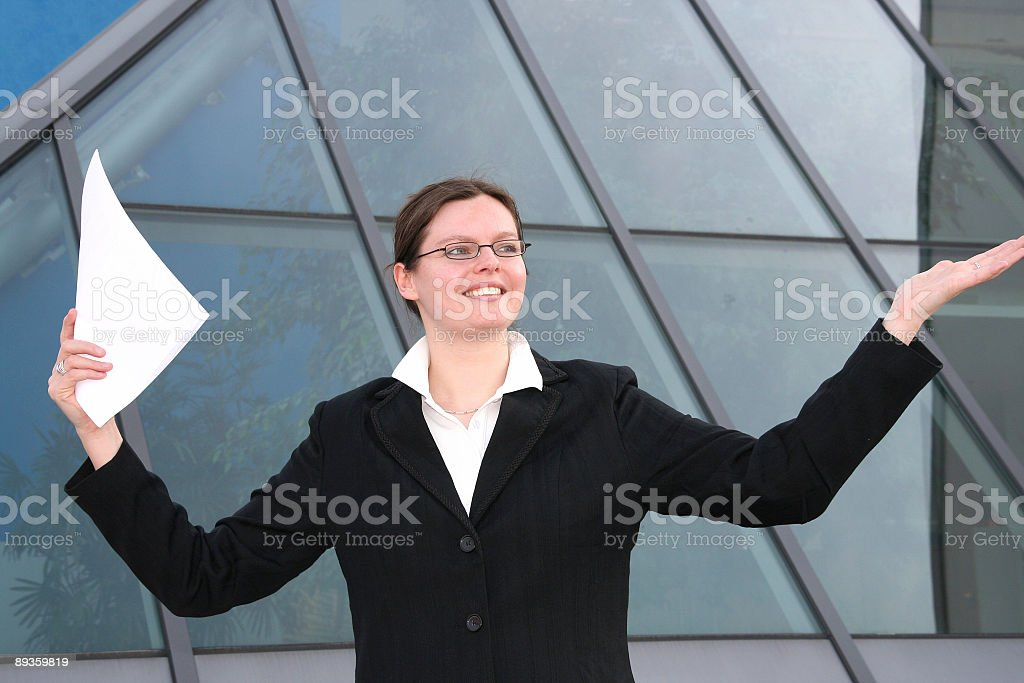 happy businesswoman with contract in her hand royalty free stockfoto