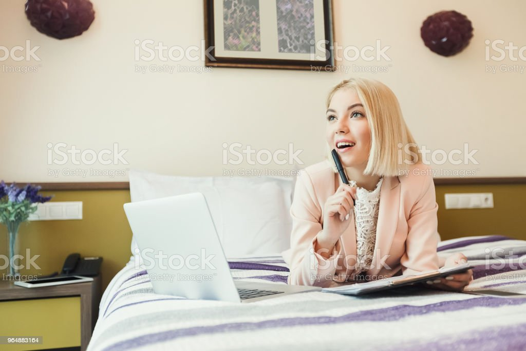 Happy businesswoman working in hotel room royalty-free stock photo