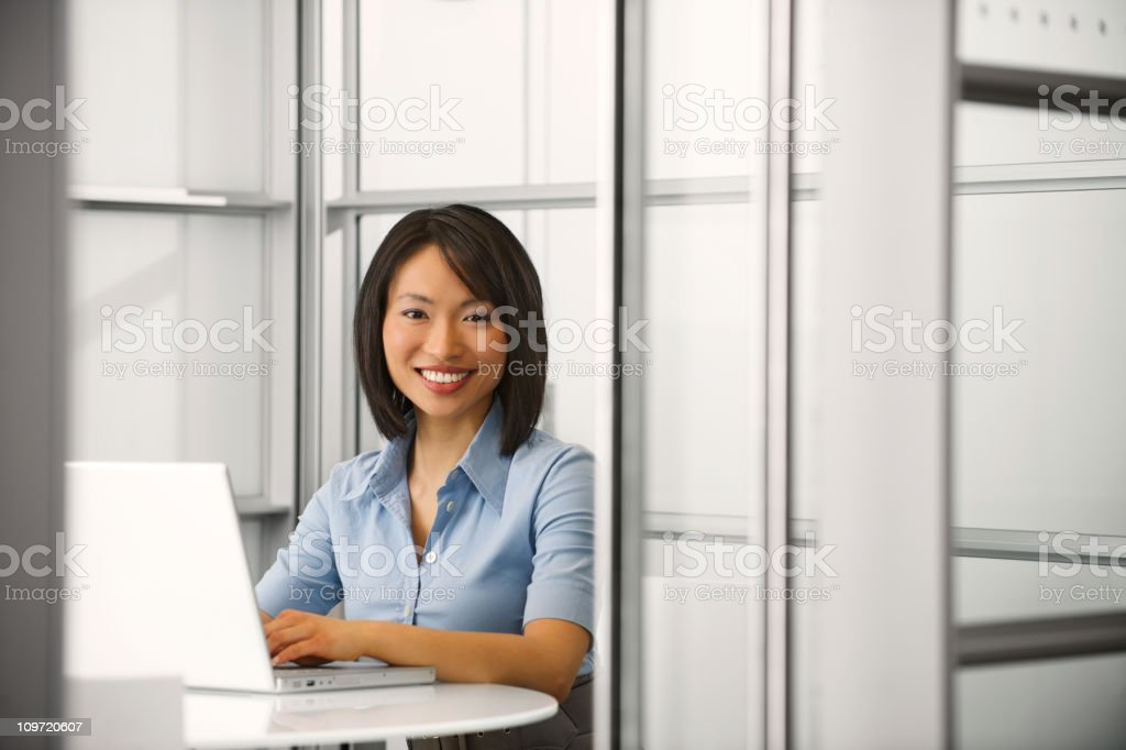Happy businesswoman working on her laptop royalty-free stock photo