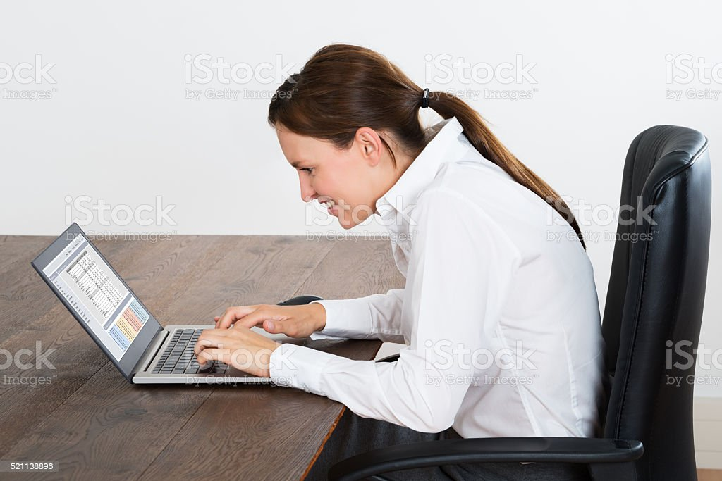 Happy Businesswoman Working On Laptop stock photo