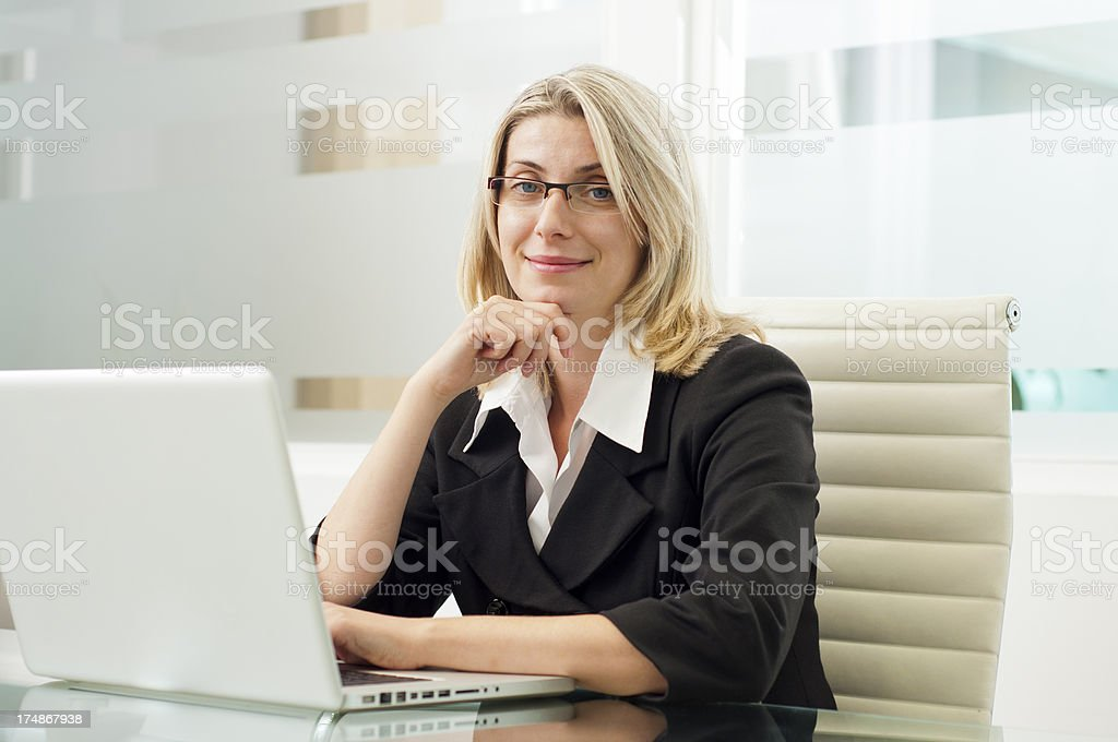 Happy businesswoman working on the laptop royalty-free stock photo