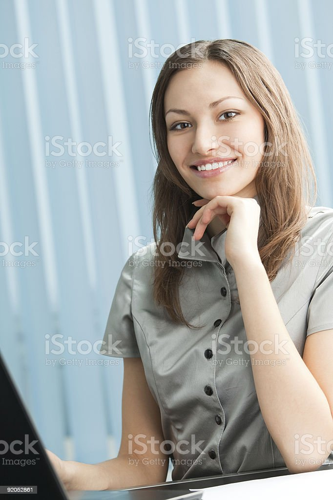 Happy businesswoman working with laptop at office royalty-free stock photo