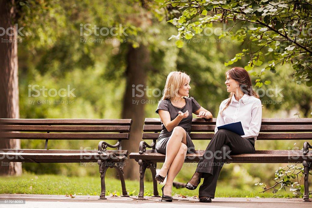 Happy businesswomen communicating. stock photo