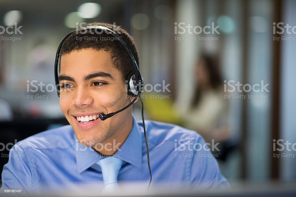 happy call centre rep stock photo