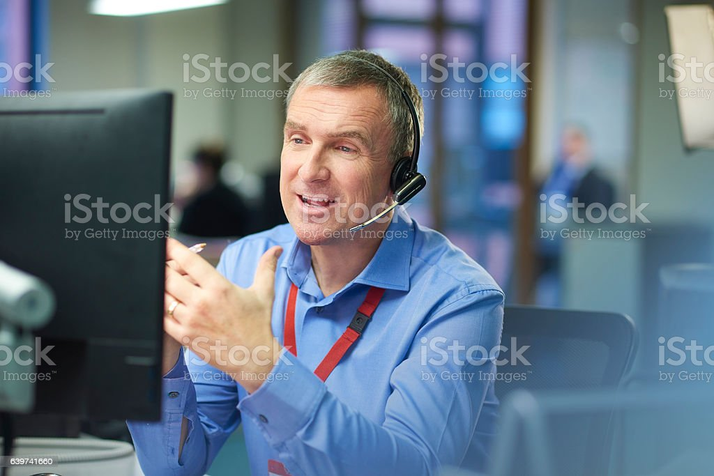 happy call centre representative stock photo