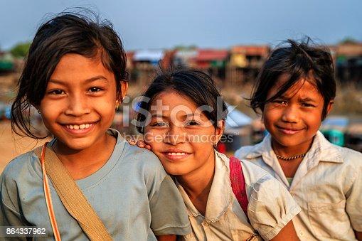 Happy Cambodian schoolgirls near Tonle Sap, Cambodia