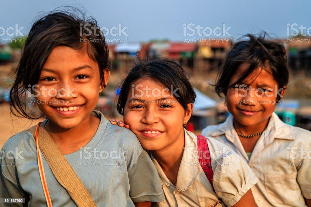 Happy Cambodian schoolgirls near Tonle Sap, Cambodia stock photo
