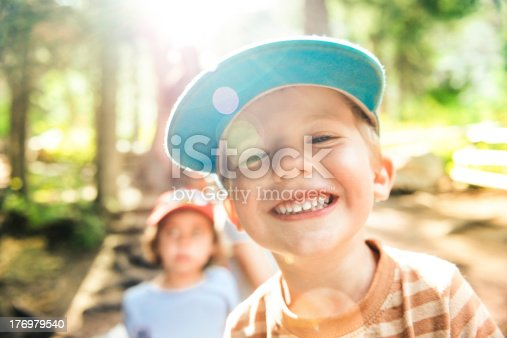 Little Boy Smiling at the camera in Campground