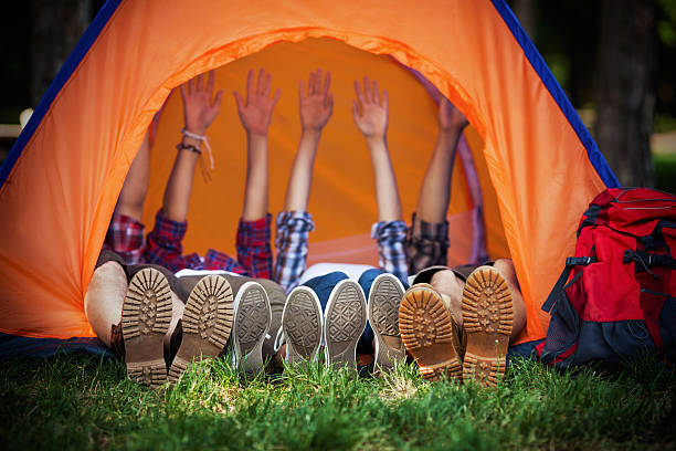 happy campers lying in a tent - camping stock photos and pictures