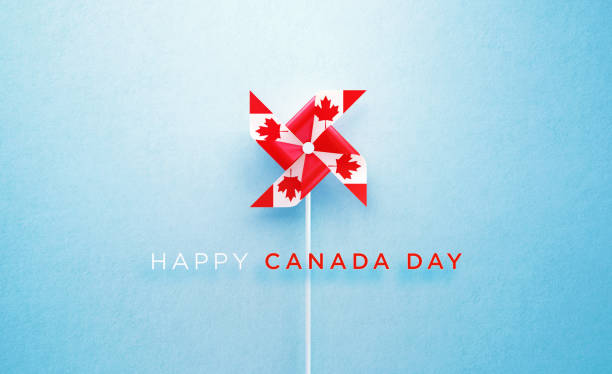 Happy Canada Day Message and Paper Pinwheel Textured with Canadian Flag on Blue Background Happy Canada Day message and paper pinwheel textured with Canadian flag on blue background. Horizontal composition with copy space. Front view. Canada Day concept. canada day photos stock pictures, royalty-free photos & images