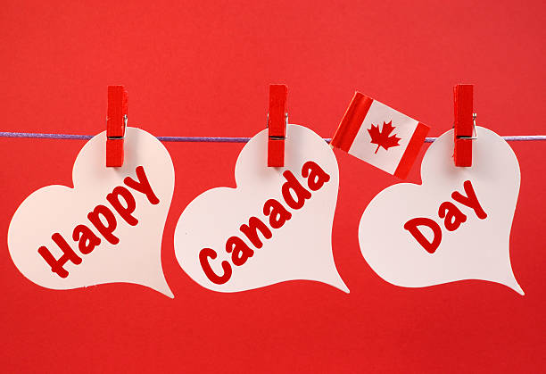 happy canada day message hanging from pegs on a line - canada day stock pictures, royalty-free photos & images