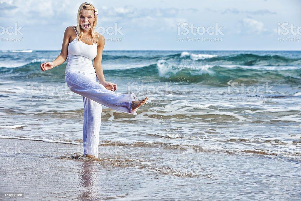 Happy Carefree Young Woman on Hawaiian Beach royalty-free stock photo