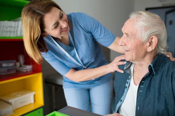 Happy caretaker assisting senior man friendly nurse supporting old picture id1150754306?b=1&k=6&m=1150754306&s=612x612&w=0&h=5yka6mgs7qnt3rh8nd7c3rhj01zn2aqzilwg49b8ggq=