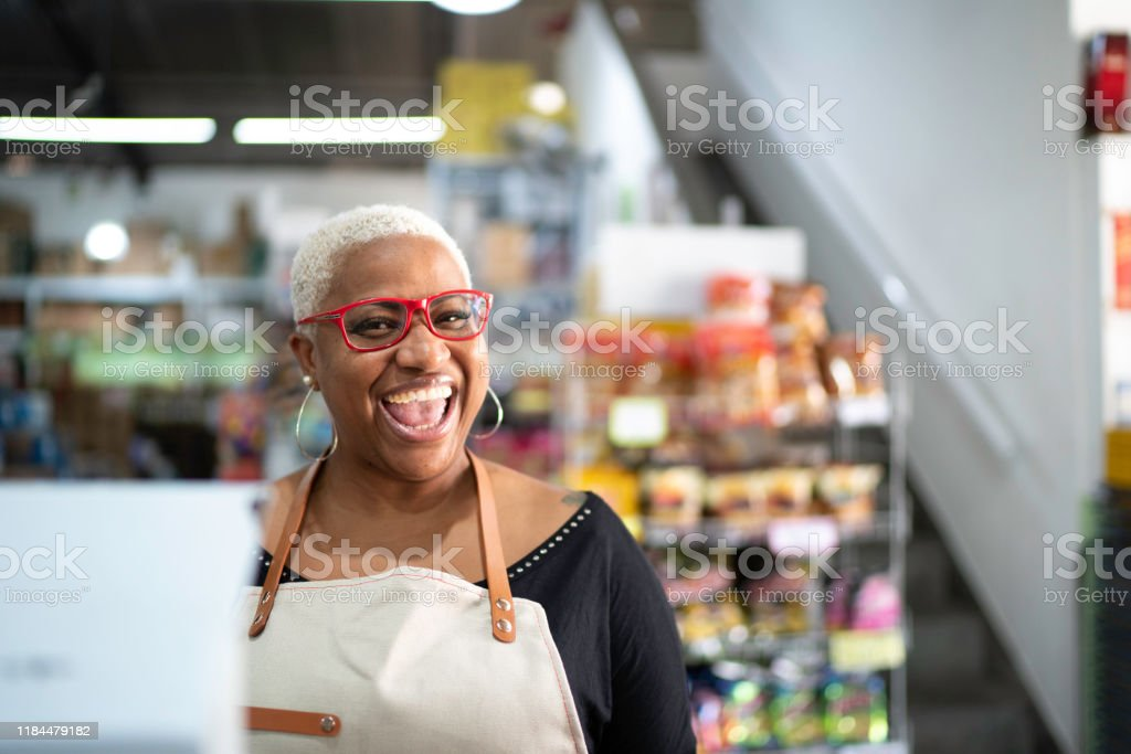 Happy Cashier werken bij Wholesale - Royalty-free 40-44 jaar Stockfoto
