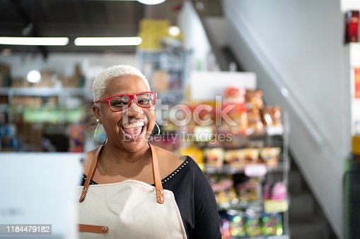 1150572074istockphoto Happy cashier working at wholesale 1184479182