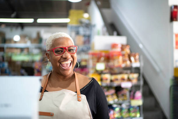 happy cashier working at wholesale - small business owner stock pictures, royalty-free photos & images