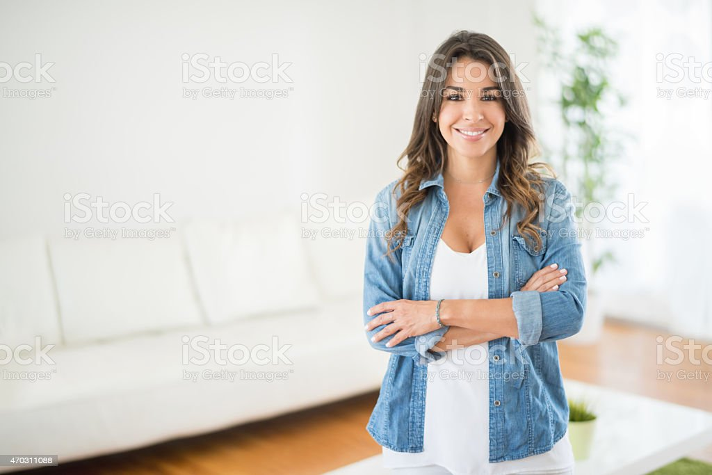 Happy casual woman at home stock photo