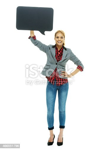 1128272390 istock photo Happy casual woman holding speech bubble 466551796