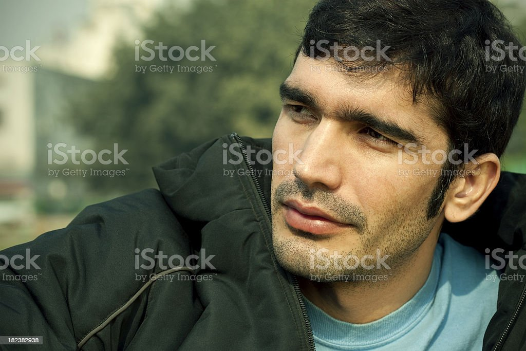 Happy casual young man looking at something royalty-free stock photo