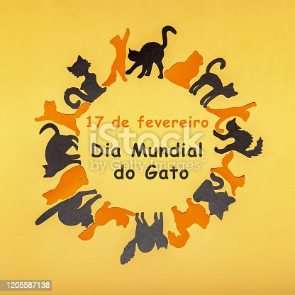 Happy Cat Day in Brazil. Round frame made of orange and black funny cat silhouettes on yellow pastel background. Festive layout for feline holiday, text in Portuguese 17 FEBRUARY CAT DAY. Flat lay.