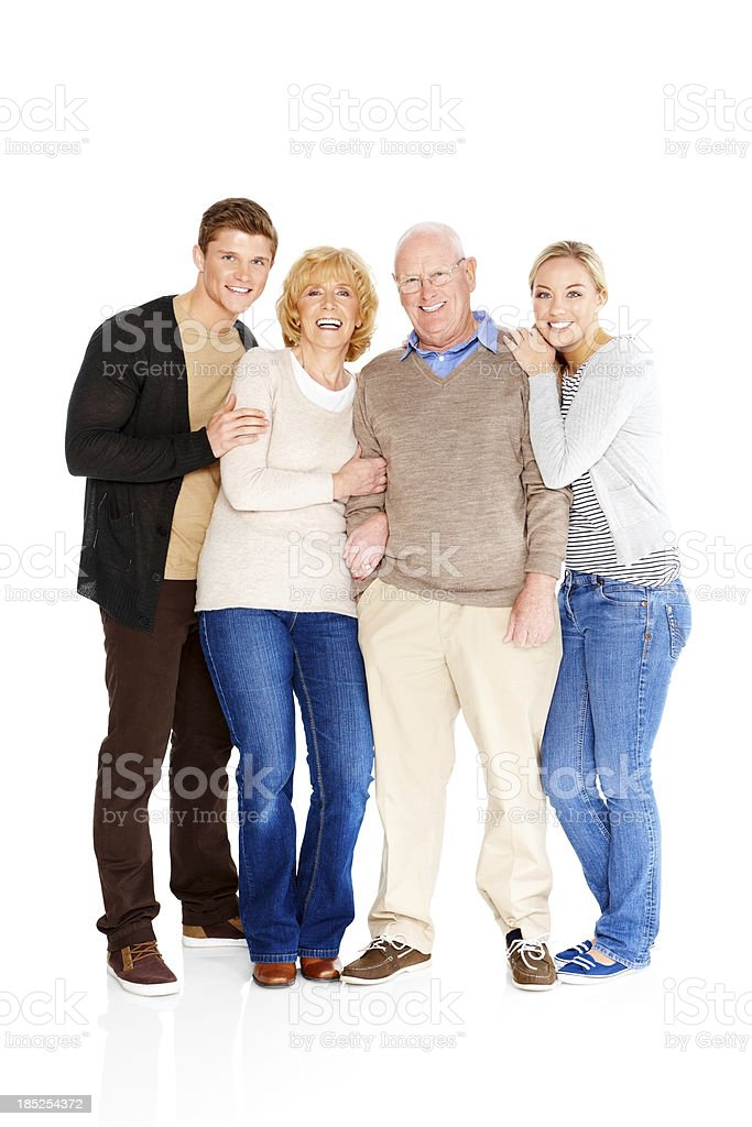 Happy Caucasian family standing together isolated on white royalty-free stock photo