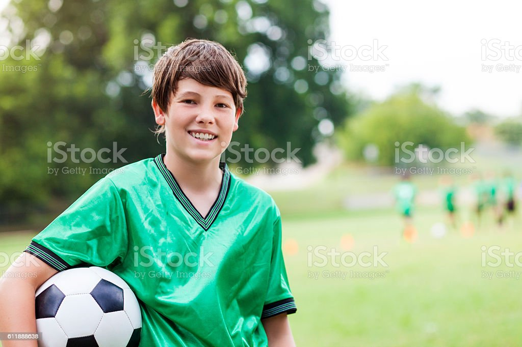 Happy Caucasian soccer player with ball stock photo