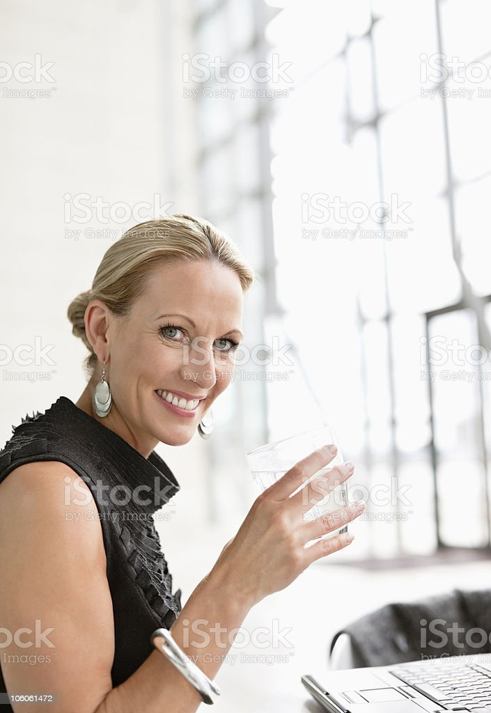 Happy Caucasian woman holding glass of water royalty-free stock photo