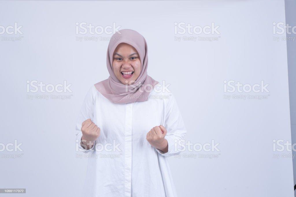 Happy Celebration of Asian Muslim Woman - Isolated stock photo