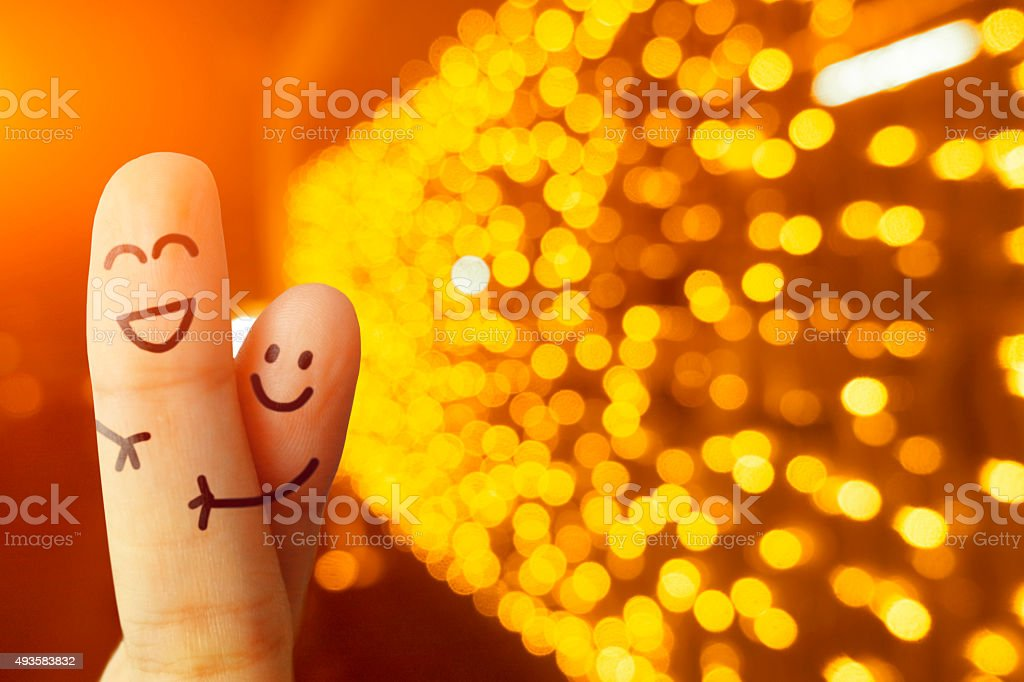 Happy smiling fingers in front of bokeh led lights