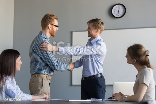 istock Happy ceo handshaking successful employee supporting congratulating with job promotion 1061027906