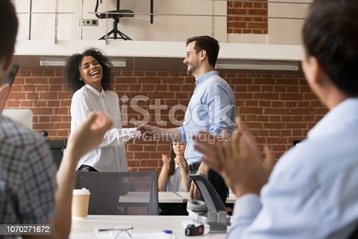 istock Happy ceo team congratulating successful african worker with job promotion 1070271672