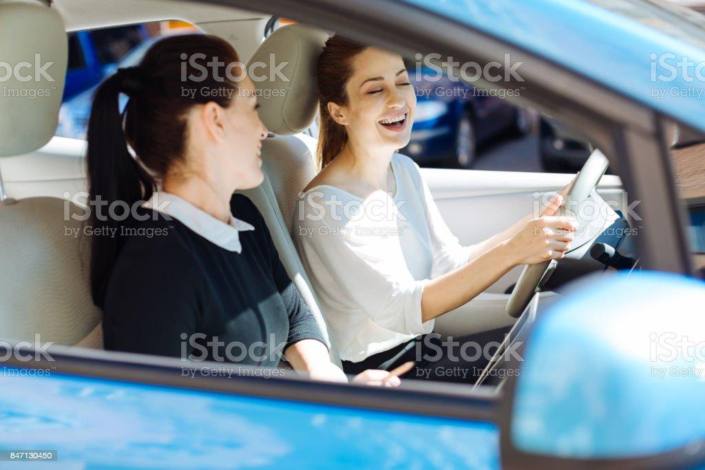 Happy cheerful businesswoman laughing stock photo
