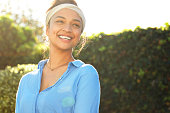 istock Happy cheerful girl laughing at park with hair band. 1282523242