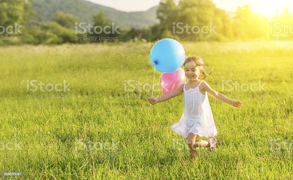 happy cheerful girl playing and having fun with balloons stock photo