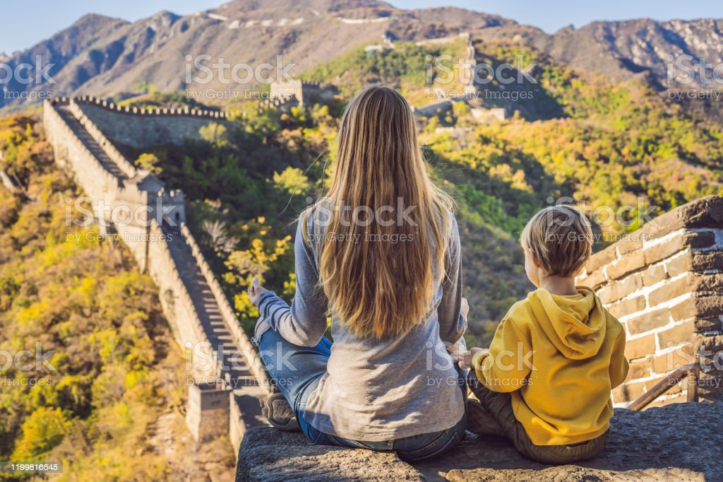 Happy Cheerful Joyful Tourists Mom And Son At Great Wall Of China Meditate On Vacation Trip In Asia Chinese Destination Travel With Children In China Concept Stock Photo Download Image Now