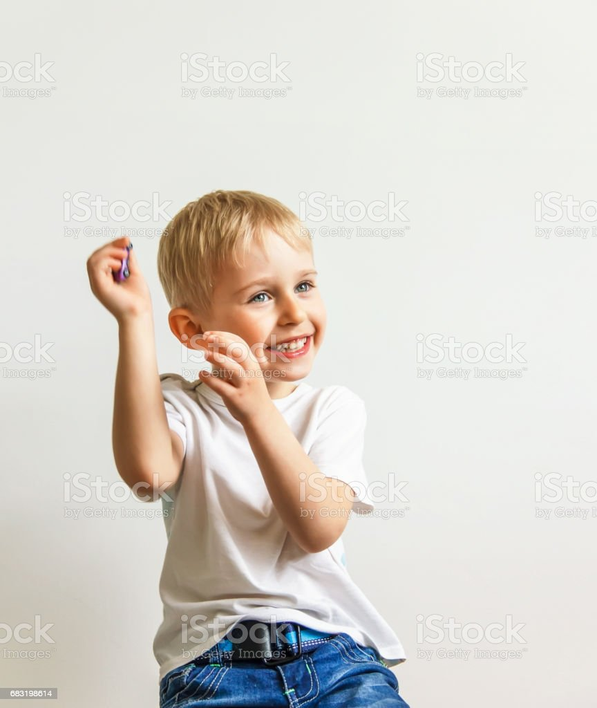 happy cheerful little boy, playing laughing making a face on white background, soft focus foto de stock royalty-free