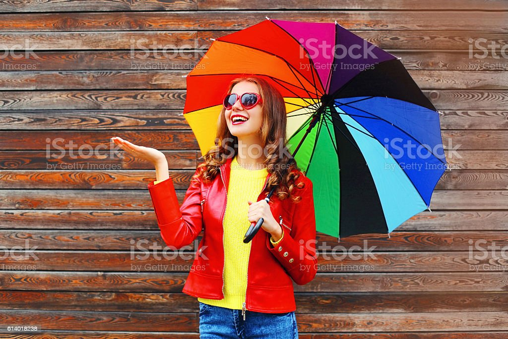 Happy cheerful smiling woman with colorful umbrella in autumn day stock photo