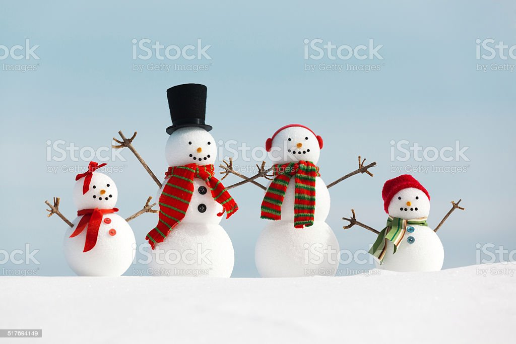 Happy Cheerful Snowman Family Humorously Enjoying Christmas Vacation Winter Holiday stock photo