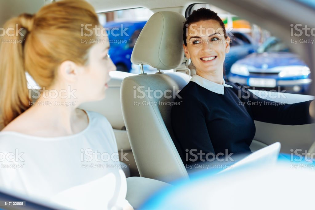 Happy cheerful women meeting together stock photo