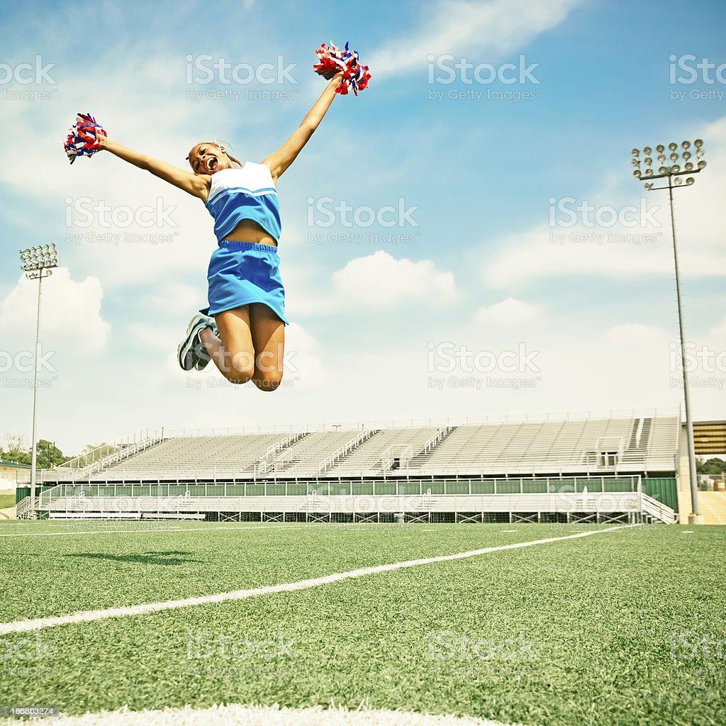 Happy cheerleader. stock photo