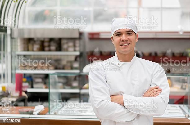 Happy chef working at a restaurant picture id520230426?b=1&k=6&m=520230426&s=612x612&h= bnxyoqwcxyzmjmqrd5vw1upyeeh0rgoq zb lhhksk=