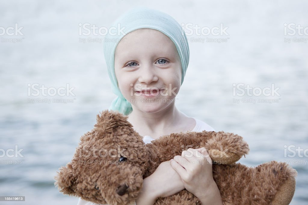 Happy Chemo Girl with Teddy Bear stock photo