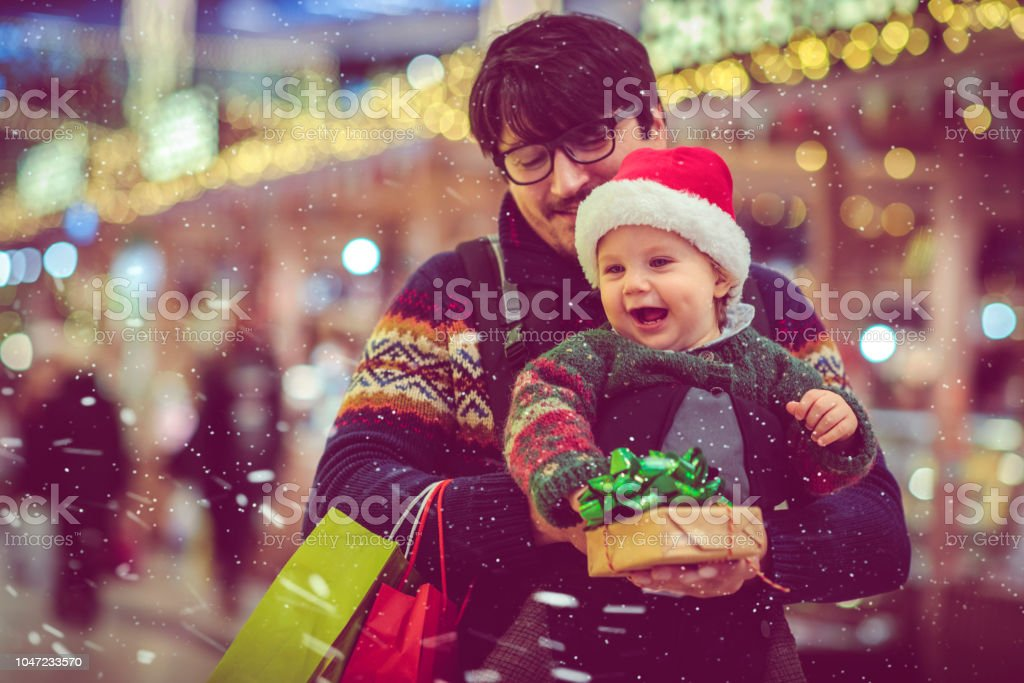 Happy child and father shopping in Christmas stock photo