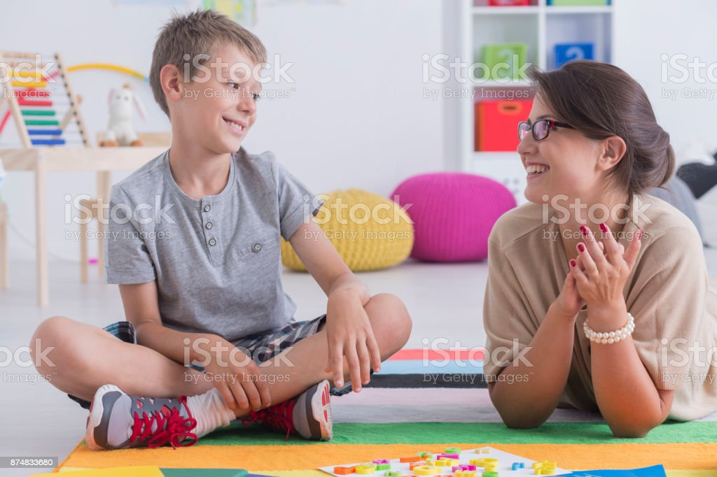 Happy child and school counselor stock photo