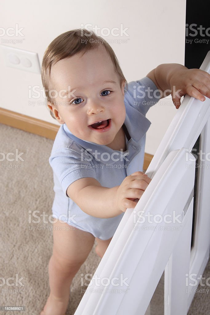 Happy Child at Baby Gate stock photo