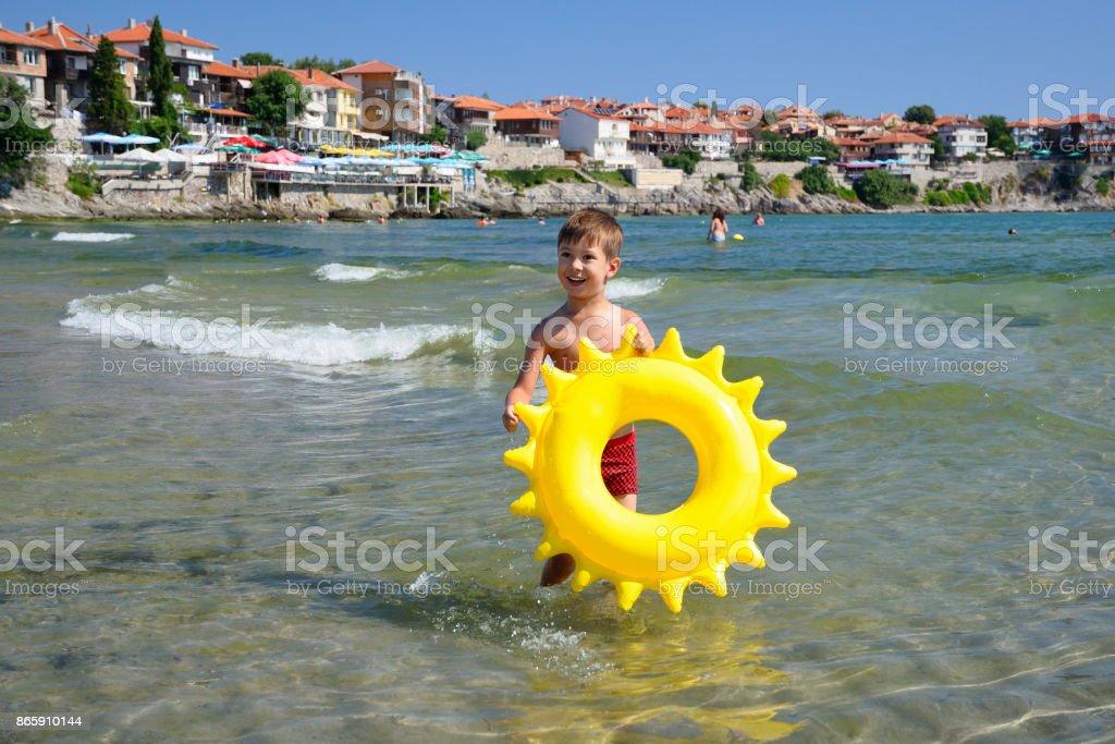 Happy child at sea beach in Sozopol, Bulgaria stock photo