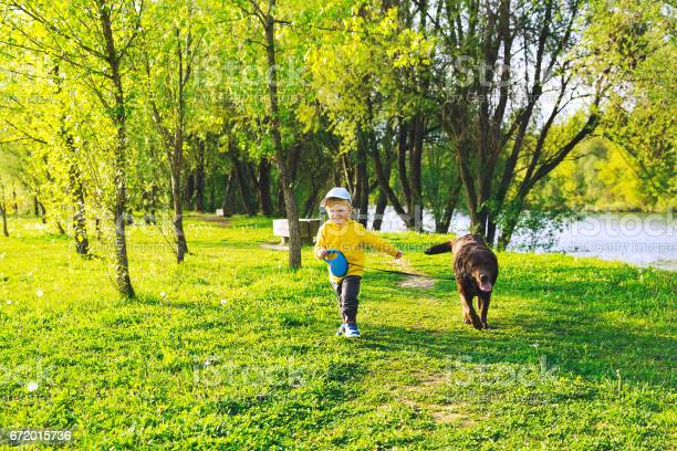 Happy child boy with his dog in the countryside at springtime picture id672015736?b=1&k=6&m=672015736&s=612x612&h=vz bktq663ozl qjeyqu  j4nbeysbzsnf1ha5afjju=