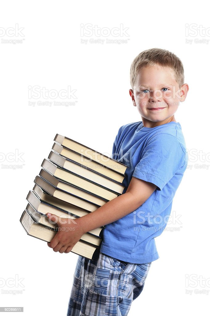 Happy child carrying books stock photo