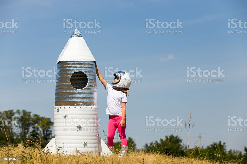 Happy child dressed in an astronaut costume stock photo