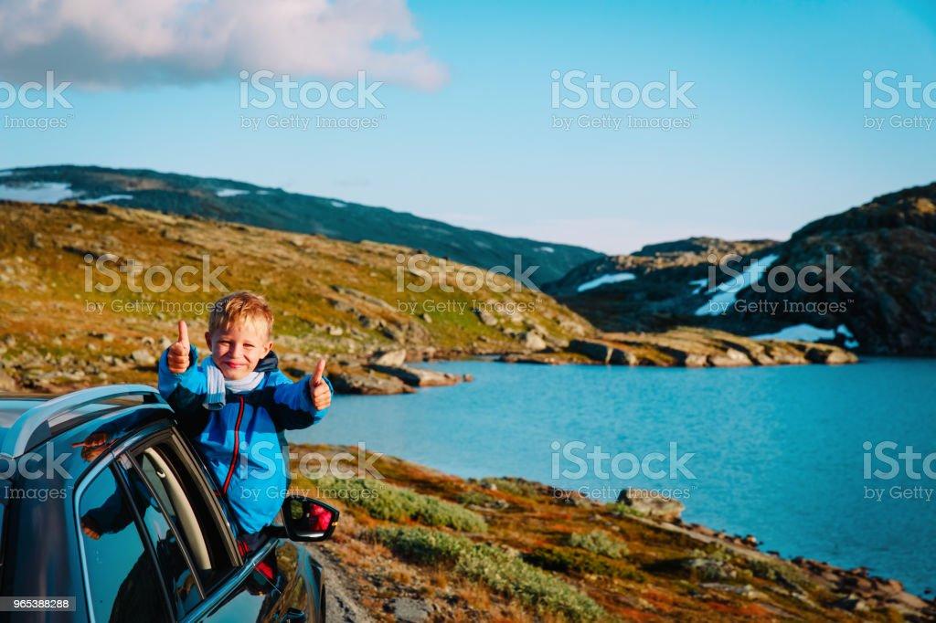 happy child enjoy travel by car in mountains zbiór zdjęć royalty-free